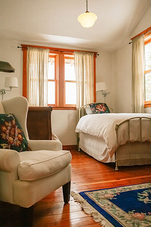 Meadow House farm stay vacation rental bedroom with three twin beds