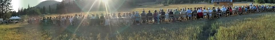 The long table at an outdoor dining event on the farm